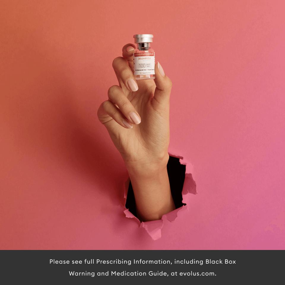 Woman holding neurotoxin bottle